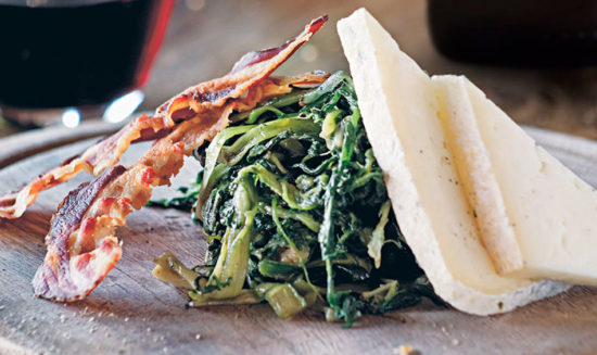Dandelion leaves with Monte Veronese cheese and crispy pancetta.